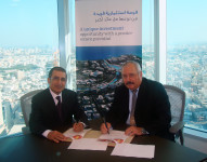 At the signing ceremony, Mr. Mohammed Khalil Alsayed, CEO Ithmaar Development Company ( Left) & Mr. Kevin Scott Ross, Country Manager, SNC Lavalin.